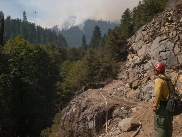 Lines lay across steep terrain. This is what Firefighters deal with. [Photo Courtesy: Inciweb]