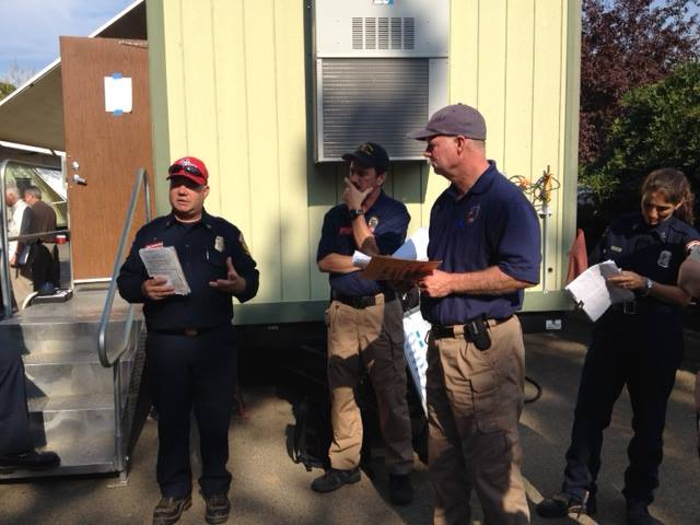 Lead PIOs coordination meeting on assignments of personnel to N & S Zones [Photo Credit: King Fire IMT via Facebook page]