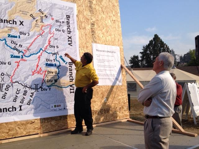 Congressman Tom McClintock getting a morning briefing on the King Fire from Operations Section Chief Keith Garolla, CA Incident Management Team 5 [Photo Credit: King Fire IMT via Facebook]