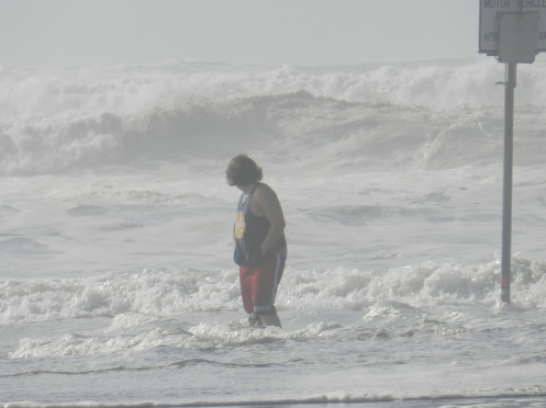 "A ""potential"" Victim stands in a sneaker wave on an Ocean Shores, Washington beach in 2014. [Credit:  LR Swenson]"
